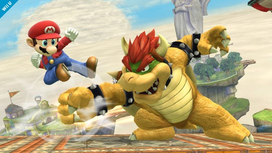 Mario fights Bowser in 'Super Smash Bros.' for Nintendo's Wii U.