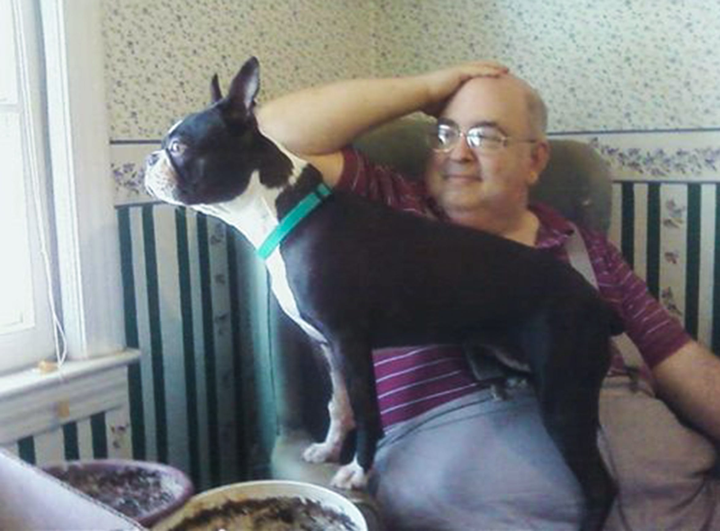 Richard Dupont of Easley and Sally the Boston Terrier in an undated family photo.