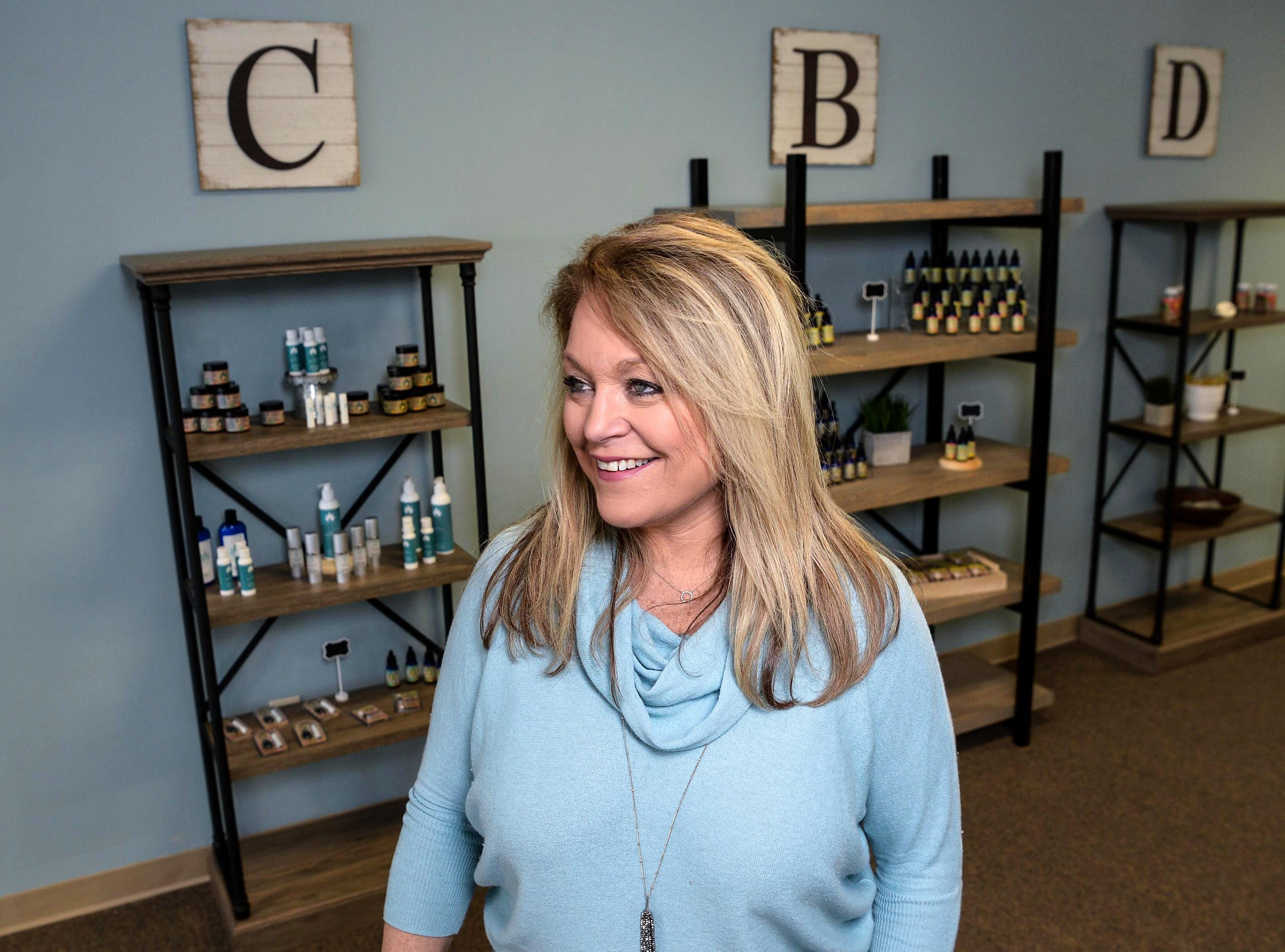 Alison Sheppard gets ready to open the Your CBD Store Anderson on Clemson Boulevard Monday, February 25. The use of the CBD (Cannabidiol) is what some use legally from cannabis plants for ailments including anxiety, seizures and pain, said Sheppard.