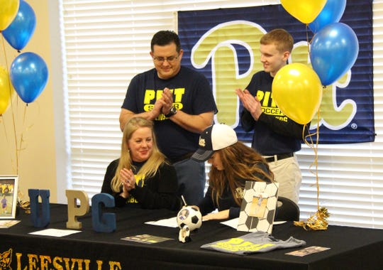 Leesville senior Sydney Parker (bottom row, right) signed with the University of Pittsburgh at Greensburg Wednesday.