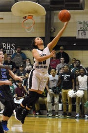Rapides senior Naomi Lewis (20) goes for a layup against Red River Senior High School in the Class 2A quarterfinals.