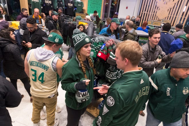 Fans shop for souvenirs in the Milwaukee Bucks Pro Shop before their game against the Portland Trail Blazers Wednesday, November 21, 2018 at Fiserv Forum in Milwaukee, Wis.