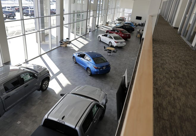 The new Kolosso Toyota building opening Monday in Grand Chute has both natural light and energy efficient LED lighting in its large showroom.