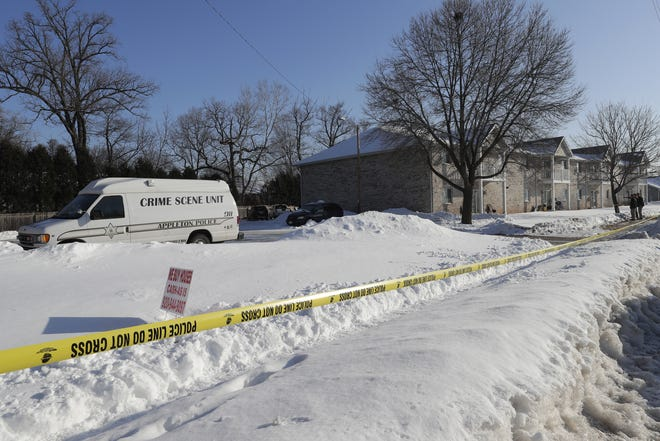 A crime scene van is part of an Appleton police investigation into a suspicious death Friday at an apartment complex in the 200 block of Valley Road.
