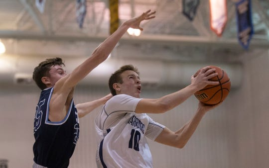 Manasquan's Benjamin Roy drives to the basket past CBA's Colin Farrell. Manasquan Boys Basketball vs Christian Brothers Academy in Shore Conference Semifinal game in Toms River, NJ. on February 21, 2019.