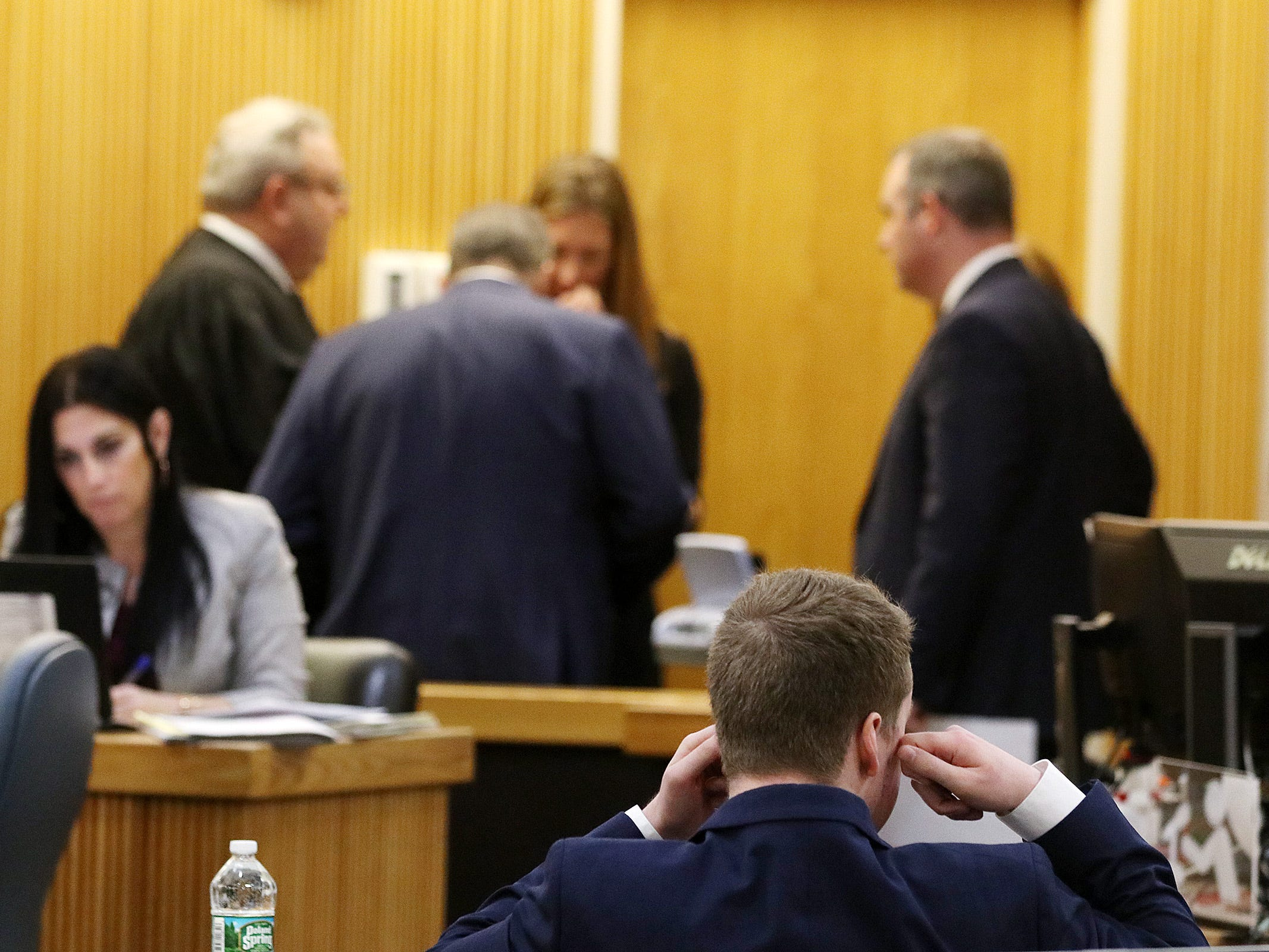 Liam McAtasney, who is charged with the murder of former high school classmate, Sarah Stern, asks for headphones to listen in on sidebar during a charging conference before closing statements during trial before Superior Court Judge Richard W. English at the Monmouth County Courthouse in Freehold, NJ Friday, February 22, 2019.
