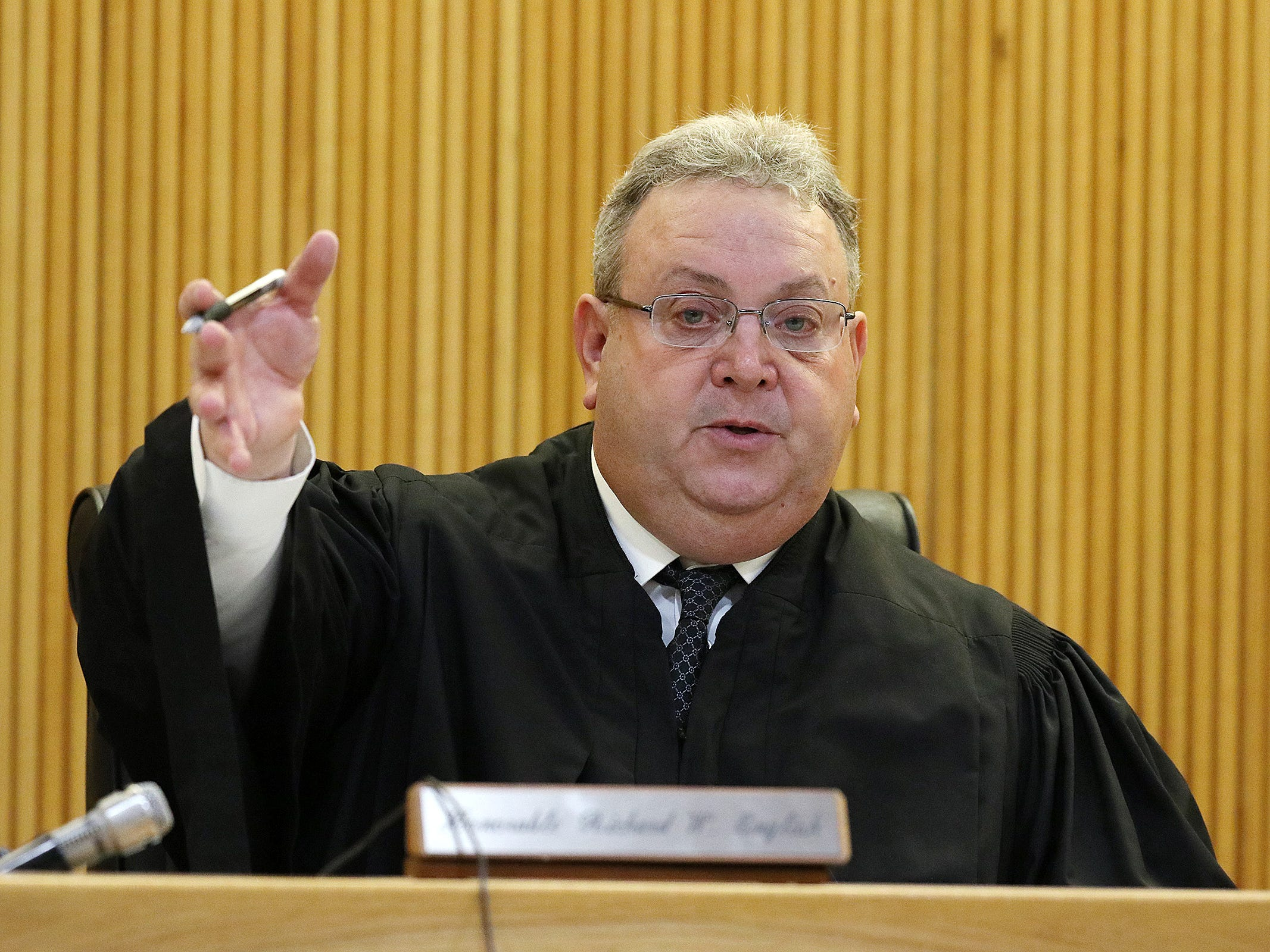 Superior Court Judge Richard W. English conferences with attorneys to amend the language in the judge's charge to the jury before closing statements during the trial of Liam McAtasney, who is charged with the murder of former high school classmate, Sarah Stern, at the Monmouth County Courthouse in Freehold, NJ Friday, February 22, 2019.