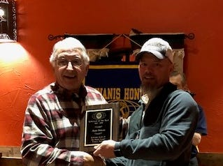 Don Holland, president elect of the Pecan Valley Kiwanis Club, presents the Kiwanian of the Year award to Rusty Roberts at the club's annual Sweethearts Awards Banquet on Feb. 15.