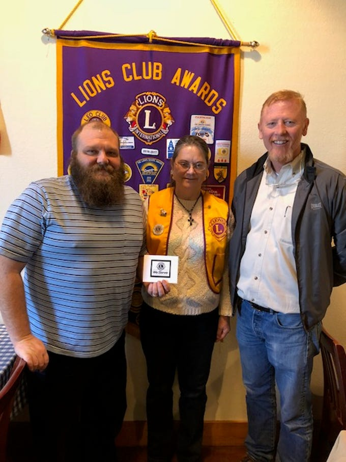 Guest speakers Kevin Puryear (left) and Pastor Brian Massey (right), both of Four Square Church, meet with Abilene Founders Lions Club member Denise Wolfe at the club's Feb. 7 meeting.