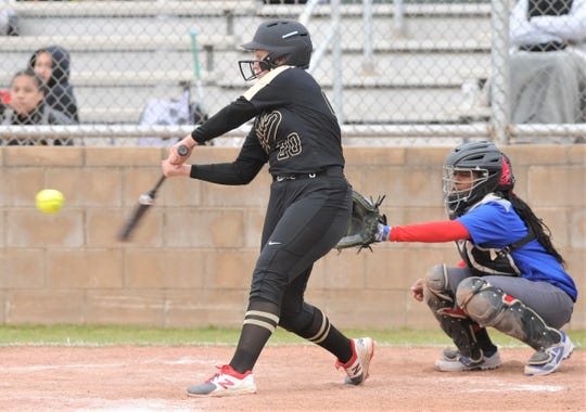 Clyde's Peyton Lee hits a three-run home run in the first inning against Cooper. She homered in all three at-bats, driving in eight runs in the Lady Bulldogs' 15-4 win over Cooper in three innings Thursday, Feb. 21, 2019, during the Abilene Ice Breaker tournament at Cougar Diamond.