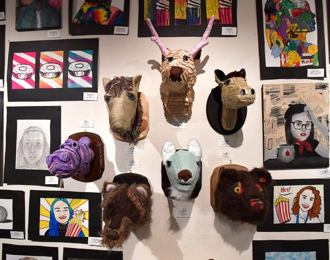 """Mixed media """"mounts"""" by Wylie Junior High student Hollie Garza at Thursday's student art exhibit at The Grace Museum."""