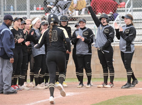 Clyde players wait to greet Kaitlyn Turner at the plate after Turner hit a solo homer following Peyton Lee's three-run blast in the first inning against Cooper. Clyde won the game 15-4 in three innings Thursday, Feb. 21, 2019, at Cougar Diamond. Turner had two homers and a double in three at-bats.