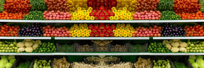 Fresh organic Vegetables and fruits on shelf in supermarket, farmers market. Healthy food concept. Vitamins and minerals. Tomatoes, capsicum, cucumbers, mushrooms