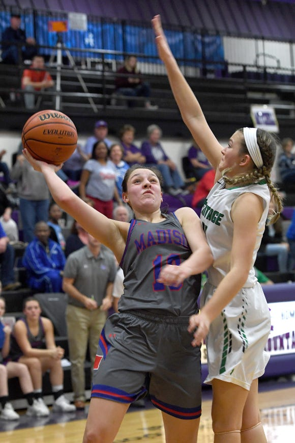 Madison's Hannah Chandler goes up for a shot against Mountain Heritage's Hannah Ray during the Western Highlands Conference tournament semi-final game at Mitchell High School on Feb. 21, 2019. Mountain Heritage defeated Madison 49-36.