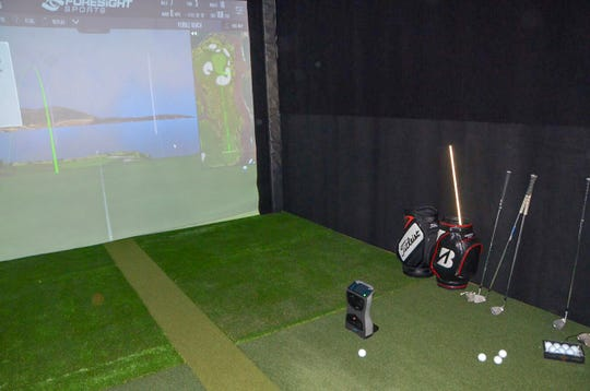 The new Mitchell Golf Performance Studio in downtown Albion, at 304 South Superior St., has a golf simulator that people can book for personal use.