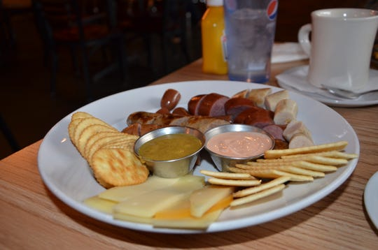 One of Territorial Brewing Co.'s menu items is the Wurst Sampler Ever, where customers get five different sausages, along with cheese, crackers and dip.