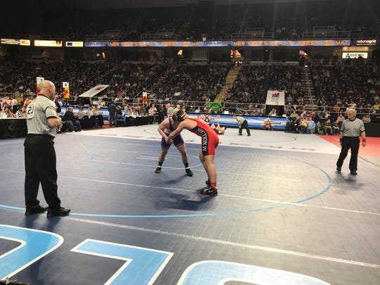 Lucas Scott of Chenango Forks, in red, competes in Friday's state wrestling tournament.