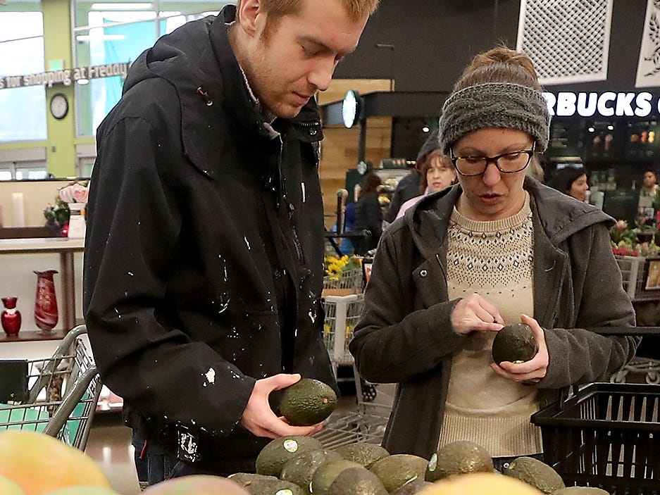 Craig Andrews gets avocado picking tips from sous chef Britney Doyle at Fred Meyer in Bremerton on Wednesday, February 20, 2019.