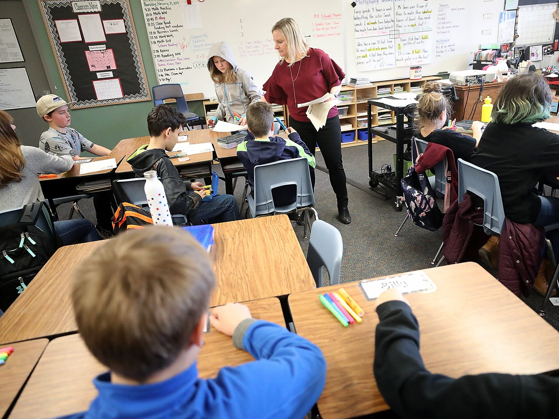 Fifth grade teacher Kristy Dressler passes out assignments during class at Suquamish Elementary School on Thursday, February 21, 2019.