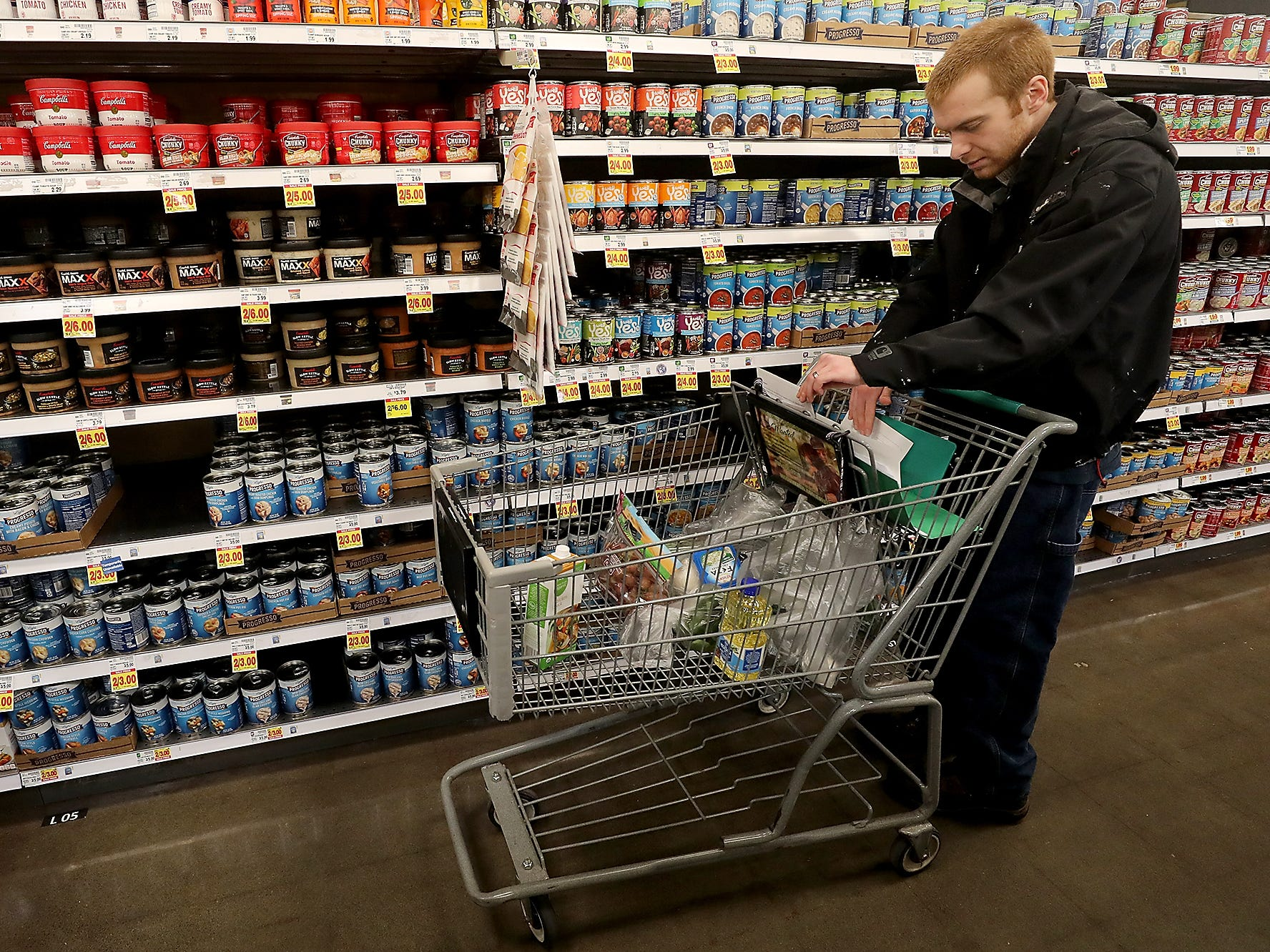Craig Andrews checks his grocery list in the soup aisle of Fred Meyer in Bremerton on Wednesday, February 20, 2019.