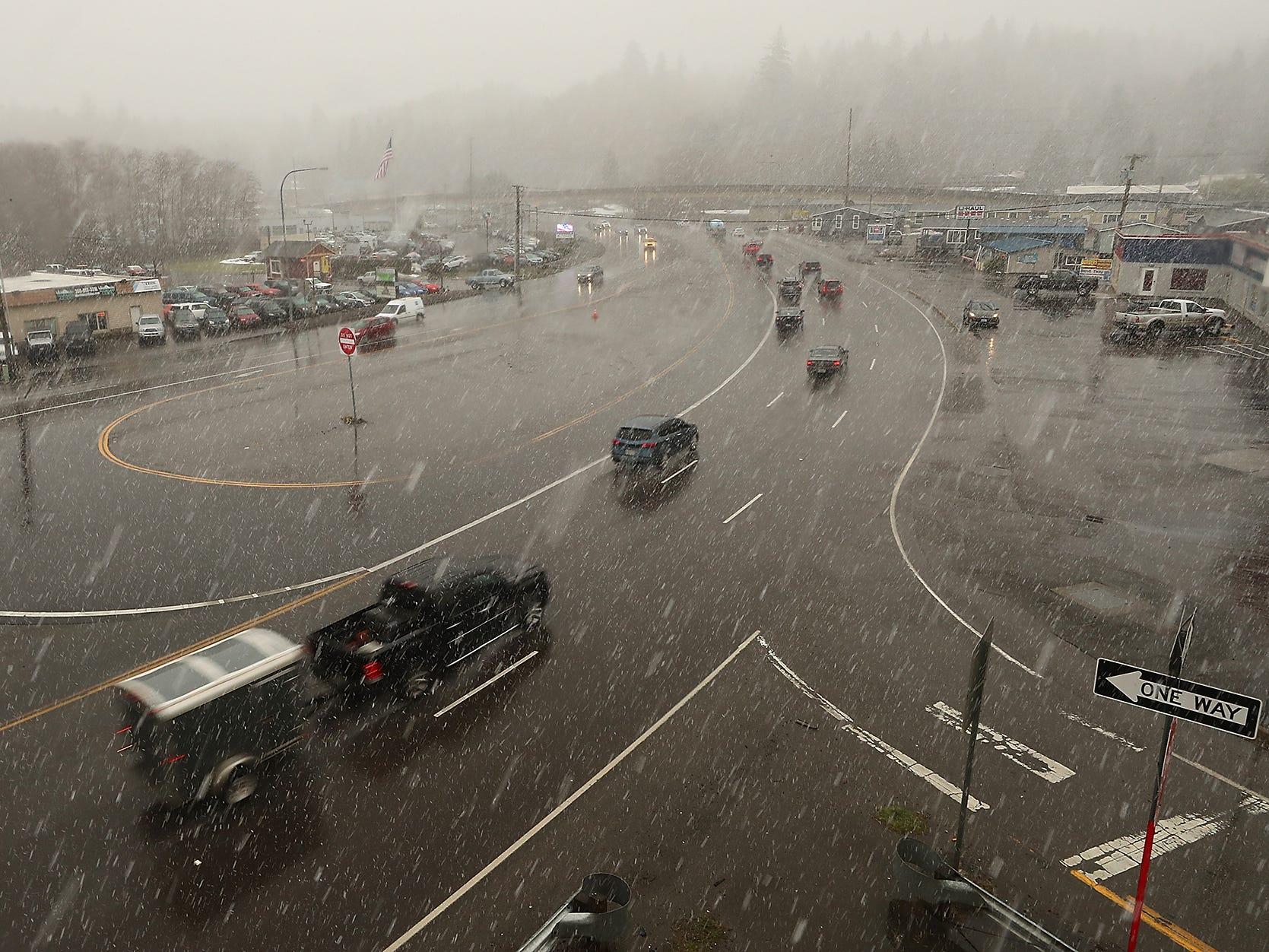 Traffic travels through Gorst on a snowy Friday, February 22, 2019.