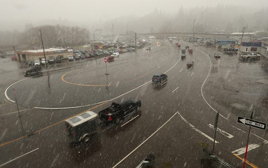 Traffic travels through Gorst on a snowy Friday. The corridor is known for congestion and accidents, and a proposal in the state Senate that would fund a variety of road projects through a carbon fee would bring added capacity in the form of more lanes and an elevated roadway in the area.