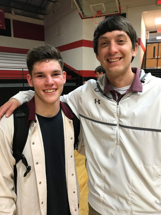 Noah Moore, left, and Warhorse head coach Clint McElrath stand for a picture in Newland after Moore picked up his 1,000th career point in the final seconds of Owen's final game of the season against Avery.