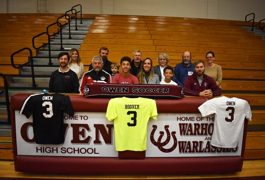 Lorenz Hoover, center, signs on Feb. 18, to play soccer for Denison University.