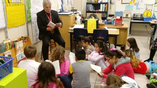 Residents volunteered to read to students at Croton Elementary School for Literacy Week.