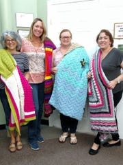 The principal and staff at University Park Elementary School made and donated afghan blankets for Love INC Brevard.