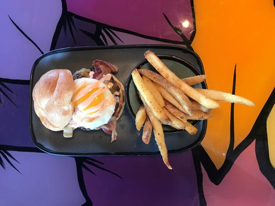 The 2 a.m. Burger, complete with a fried egg and bacon, is among the offerings on the 4th Street Fillin Station menu.