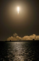 A SpaceX Falcon 9 rocket lifts off from Cape Canaveral Air Force Station Thursday evening, The rocket is carrying an Indonesian communications satellite and an Israeli lunar lander.