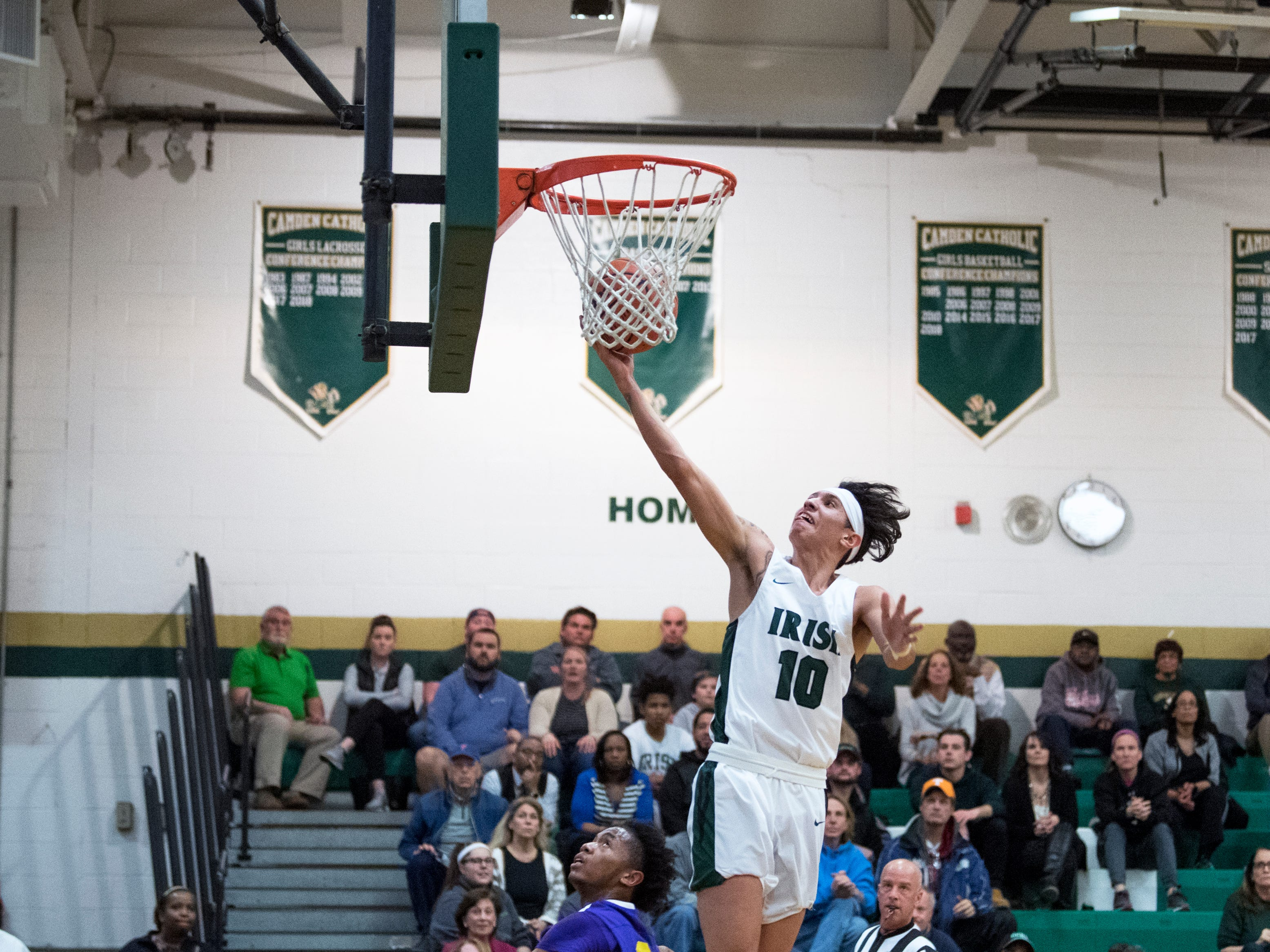 Camden Catholic's Valen Tejeda (10) drives to the basket against Camden Thursday, Feb. 21, 2019 at Camden Catholic High School in Cherry Hill, N.J. Camden Catholic won 57-54.