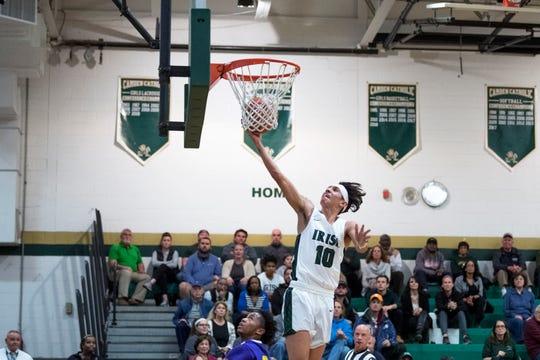 Camden Catholic's Valen Tejeda (10) drives to the basket against Camden Thursday, Feb. 21, 2019 at Camden Catholic High School in Cherry Hill, N.J. Camden Catholic won 57-54.