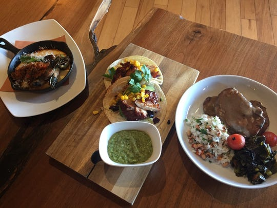 Keg & Kitchen is paying tribute this month to African-American inspired cuisines. From left: Cajun Shrimp & Grits, BBQ Chicken Tacos and Smothered Pork Chops with Black Pepper Rice and Utica Greens.