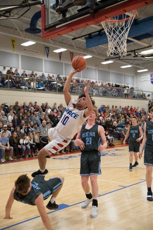 Zane Trace junior Cam Evans shoots a lay-in to make his historic 1000-point basket on Friday, February 15, 2019, against Adena High School. Zane Trace defeated Adena 67-52 to clench their first Gold Ball since 2001, with Evans scoring a total of 29 points for the night.