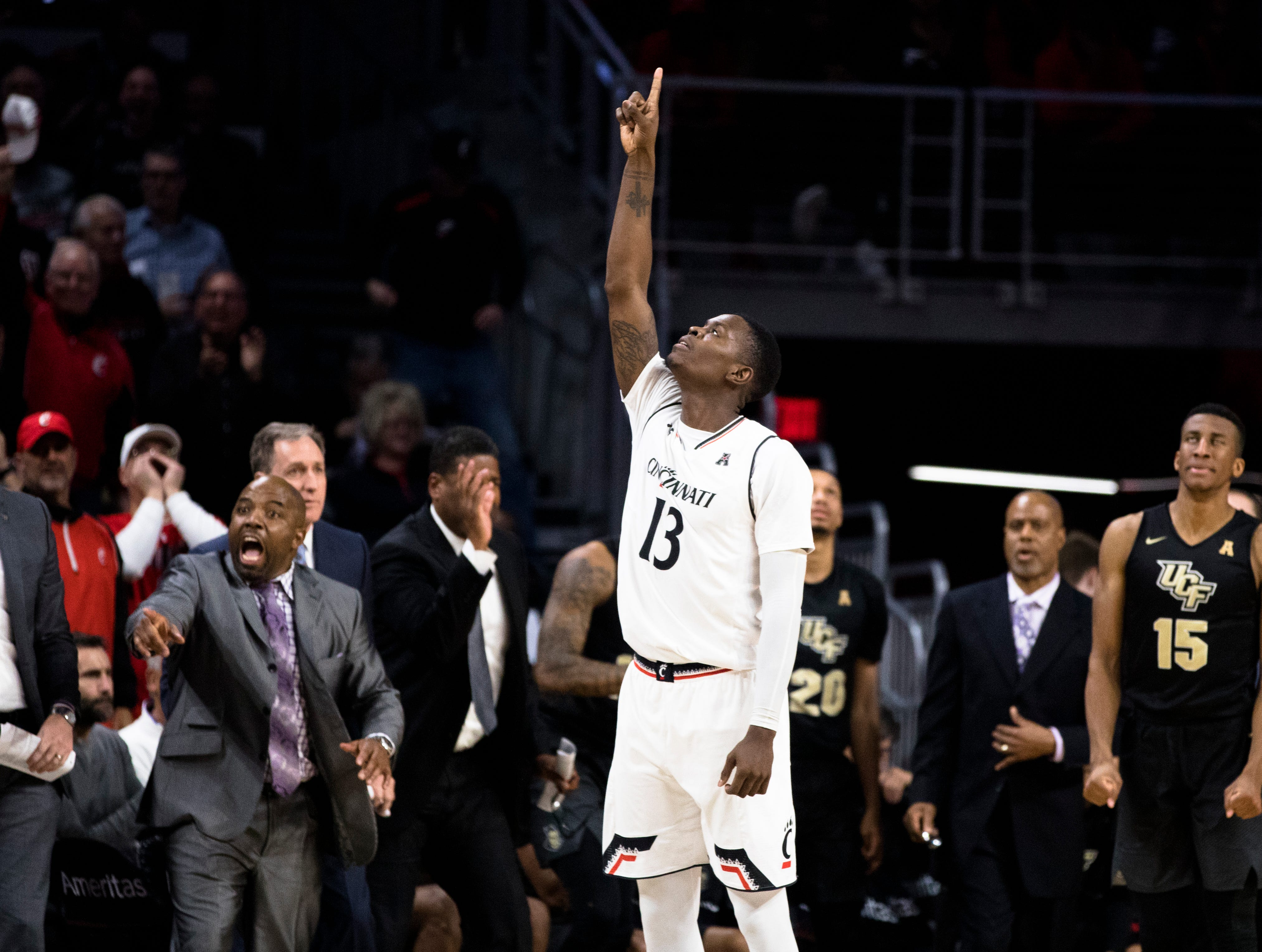Cincinnati Bearcats forward Trevon Scott (13) celebrates after hitting a 3-pointer in the second half of the NCAA men's basketball game between Cincinnati Bearcats and UCF Knights on Thursday, Feb. 21, 2019, at Fifth Third Arena in Cincinnati.