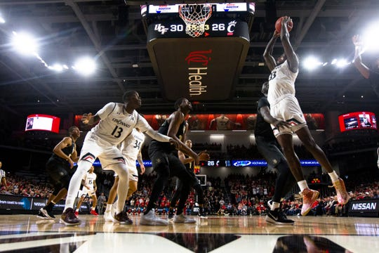 Cincinnati Bearcats center Nysier Brooks (33) dunks over UCF Knights center Tacko Fall (24) in the second half of the NCAA men's basketball game between Cincinnati Bearcats and UCF Knights on Thursday, Feb. 21, 2019, at Fifth Third Arena in Cincinnati.