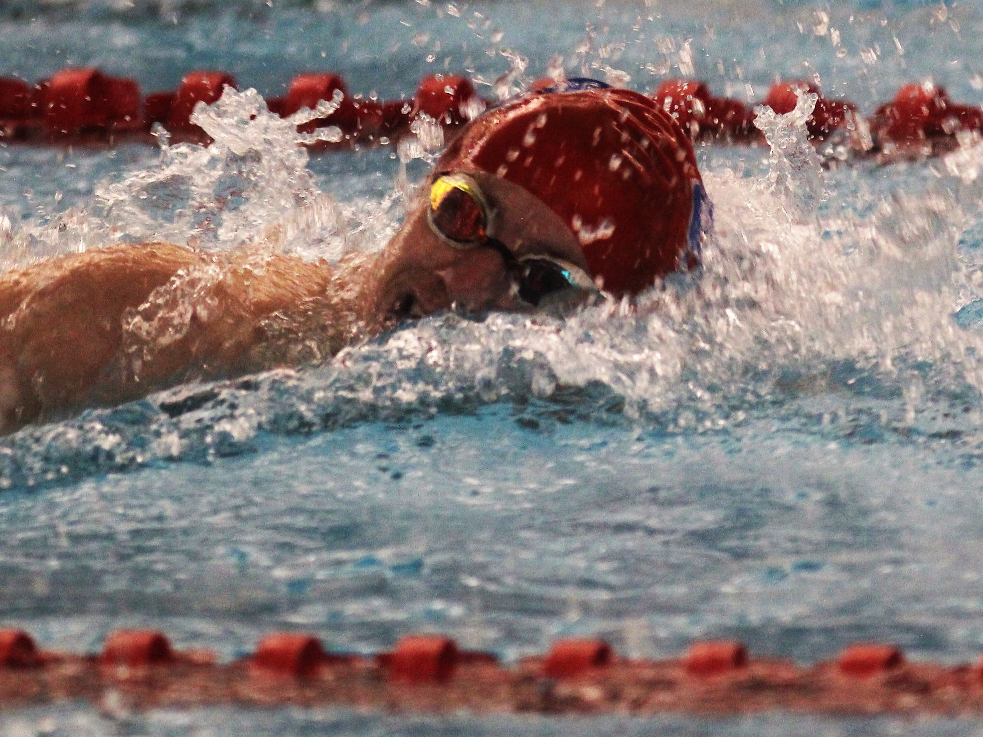 Conner senior Tommy Johnson swims the 200 freestyle during the KHSAA state boys swimming and diving championship Feb. 22, 2019 at the University of Louisville.