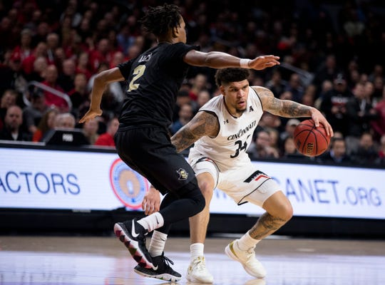 Cincinnati Bearcats guard Jarron Cumberland (34) drives on UCF Knights guard Terrell Allen (2) in the second half of the NCAA men's basketball game between Cincinnati Bearcats and UCF Knights on Thursday, Feb. 21, 2019, at Fifth Third Arena in Cincinnati.