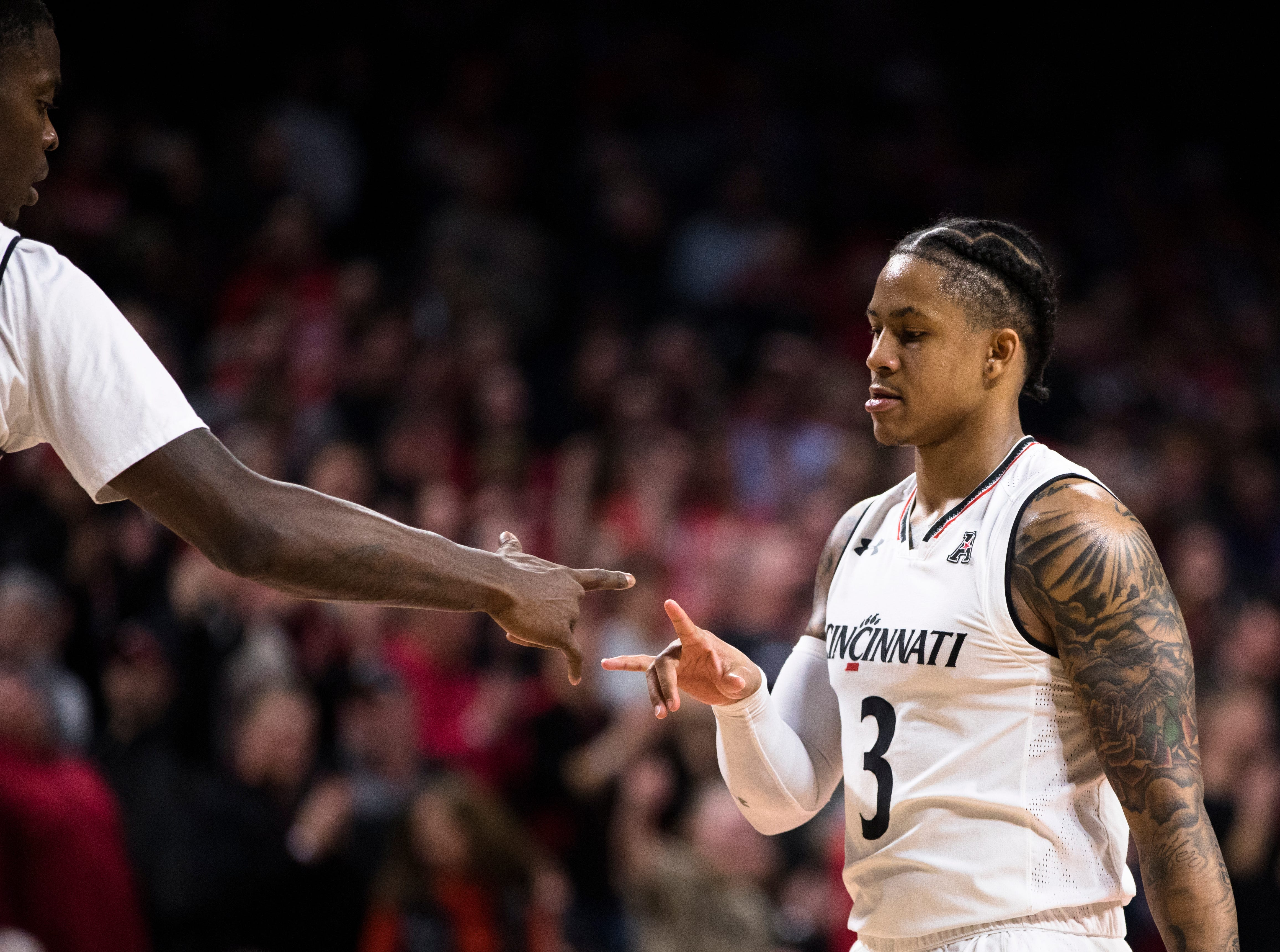 Cincinnati Bearcats guard Justin Jenifer (3) celebrates after hitting a free throw in the second half of the NCAA men's basketball game between Cincinnati Bearcats and UCF Knights on Thursday, Feb. 21, 2019, at Fifth Third Arena in Cincinnati.
