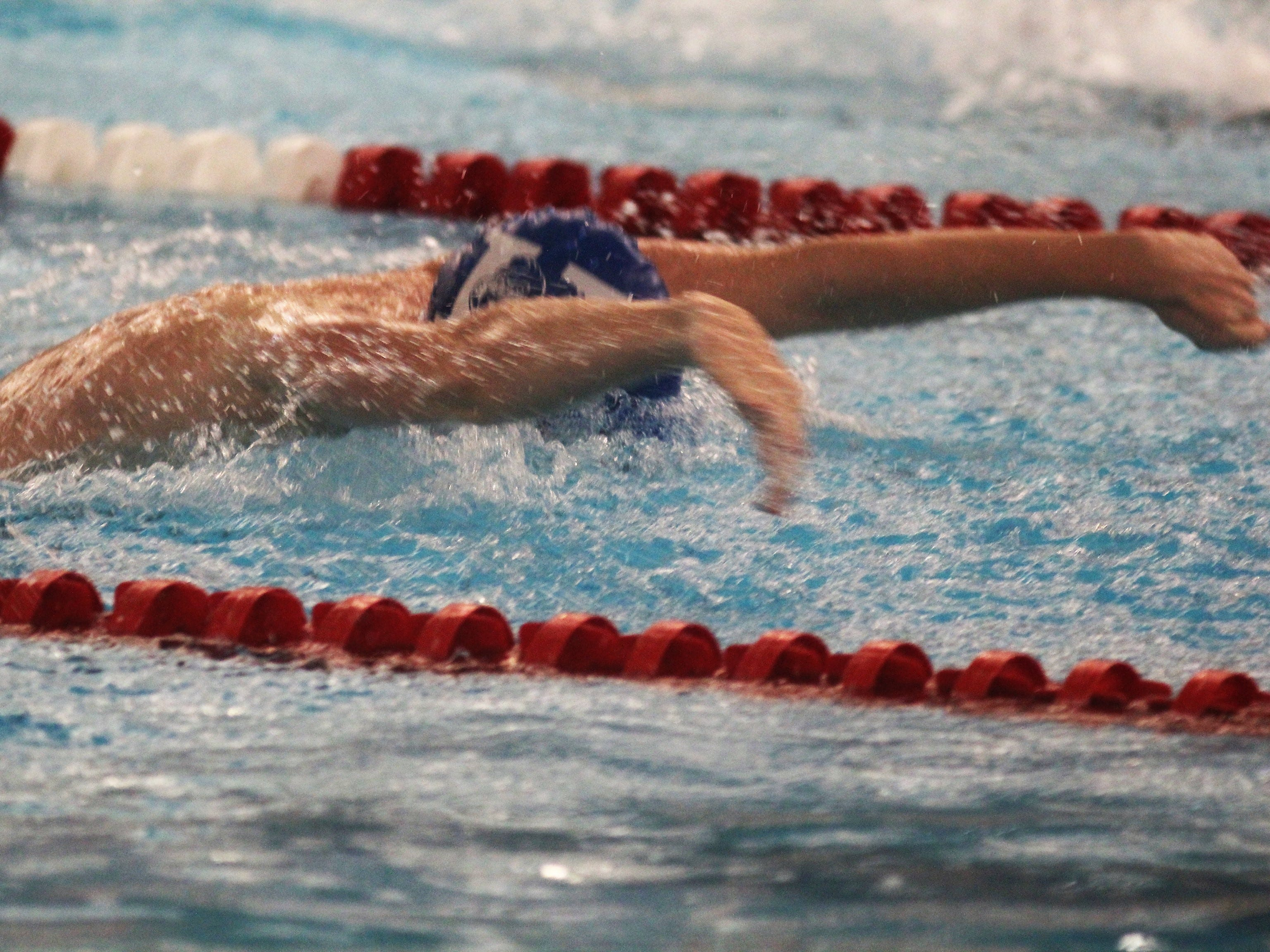 CovCath sophomore Parker Knollman in the medley relay during the KHSAA boys state swimming and diving championships Feb. 22, 2019 at the University of Louisville.