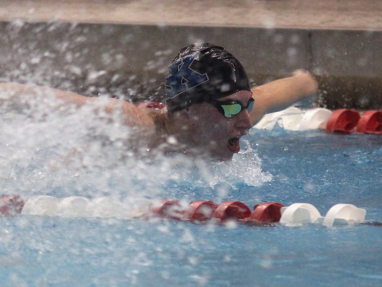 Simon Kenton senior Braden Chow in the 100 butterfly during the KHSAA boys state swimming and diving championships Feb. 22, 2019 at the University of Louisville.