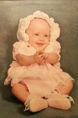 A photo of Rhonda Shiflett, as a baby, hangs in the hallway of the home she shares with her mother. Hamilton High School arranged for Rhonda to participate in an early graduation ceremony to accommodate Rhonda's mother, Verenda Shiflett, who is in hospice care with a lung disorder.