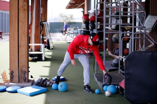 Cincinnati Reds starting pitcher Sonny Gray (54) warms up with medicine balls after scratching from his start in tomorrow's pre-season opener at the Cincinnati Reds spring training facility in Goodyear, Ariz., on Friday, Feb. 22, 2019.
