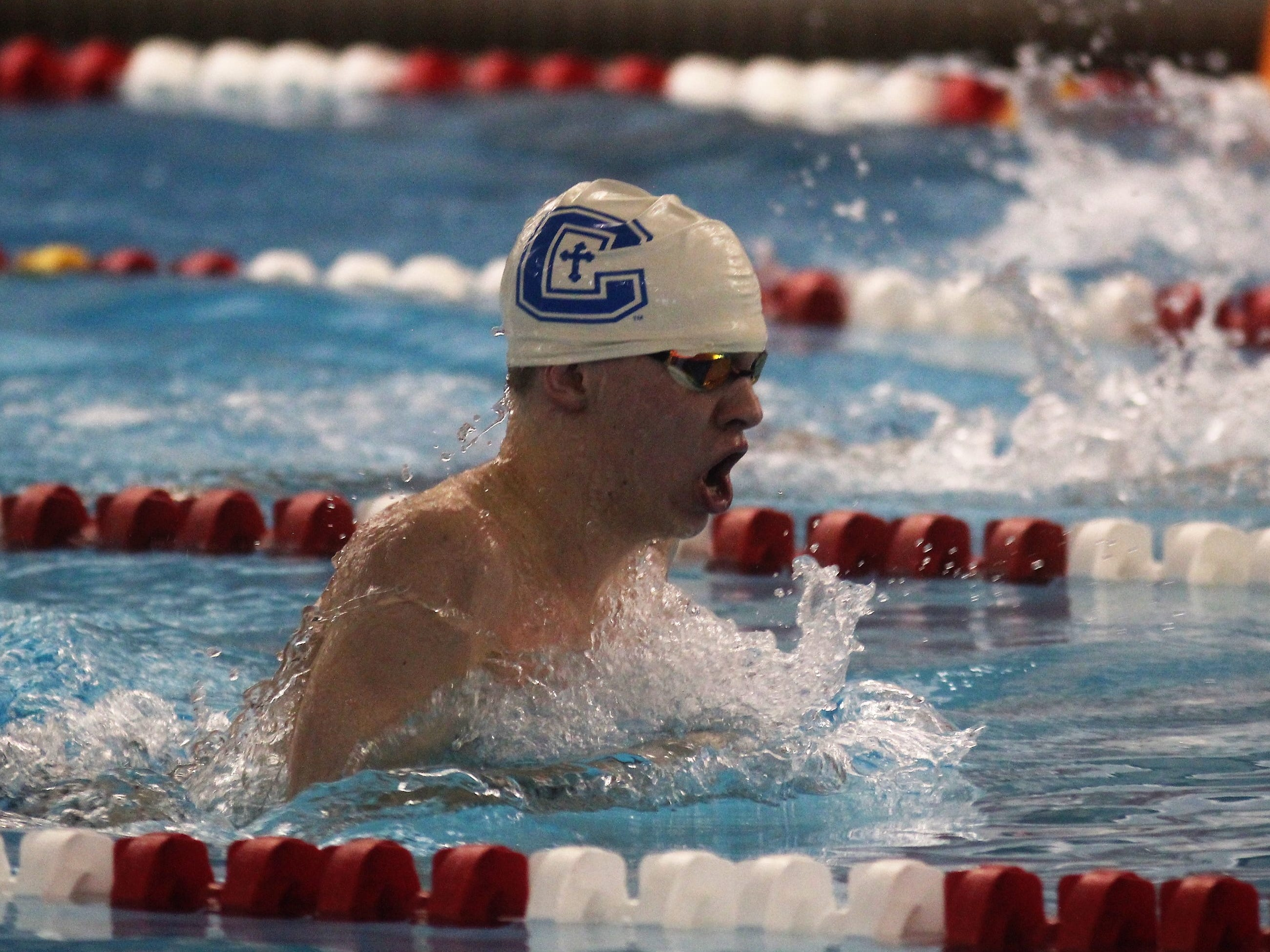 CovCath senior Bradley Kathman swims the 200 IM during the KHSAA state boys swimming and diving championship Feb. 22, 2019 at the University of Louisville.