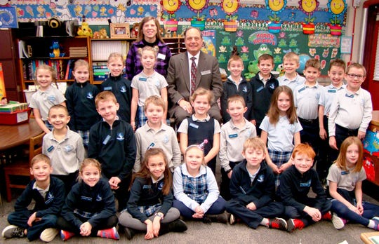 Mayor Angelo Penque of Cold Spring poses with Mrs. Jana Hagedorn and students after visiting her second grade class, where he read a story, answered questions and signed autographs.