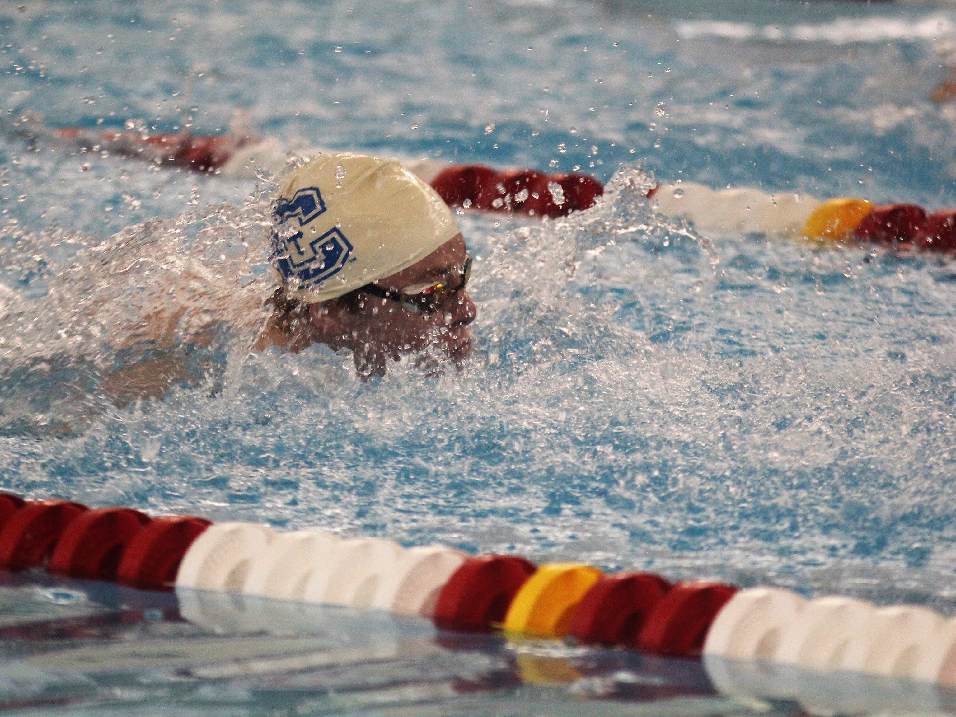 CovCath sophomore Parker Knollman in the 100 butterfly during the KHSAA boys state swimming and diving championships Feb. 22, 2019 at the University of Louisville.