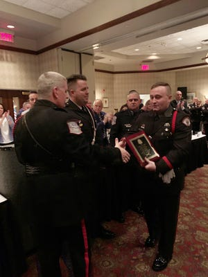 University of Cincinnati Police Officer Adam Hubbard receives the Honor Guard Officer of the Year Award at the Hamilton County Police Association Annual Awards and Installation Banquet.