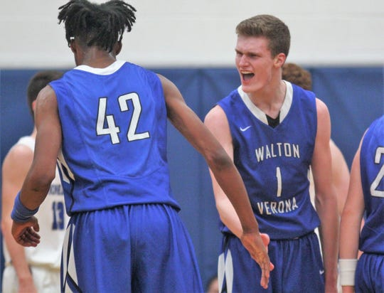 Walton-Verona's Ethan Brook congratulates Dieonte Miles after Miles scored a basket as Walton-Verona beat Simon Kenton 62-52 in the 32nd District boys basketball final Feb. 21, 2019 at Simon Kenton High School, Independence KY.